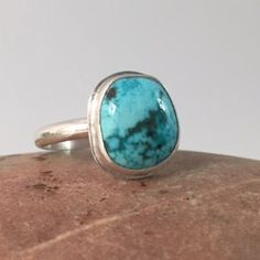 Turquoise Ring, Size 7 1/2, Sterling Silver  This ring features a square dark & light blue turquoise stone enrobed in a simple bezel and a very thin border. It sits atop a hand formed, single, 10-gauge sterling silver ring band. Ring details: Size- 7 1/2 Dimension of ring top- 1/2 x 1/2 x 3/16 (approx) Weight- 4 grams (light weight, but very sturdy, everyday ring) Band Width: 2.5 mm (read note below, please) Zodiac Birthstone: Sagittarius (22 Nov - 21 Dec) Chakra Associations: Throat…
