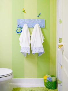 This kids' bathroom features frogs, dragonflies and lily pads.