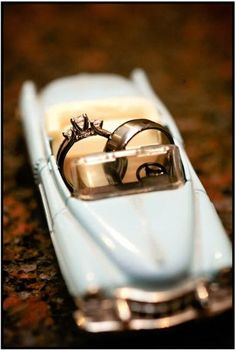 Ring shot in a toy car - so cute. Maybe I'll be able to find a mustang for this shot. :)