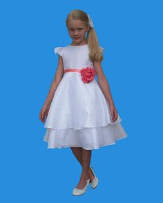 0ef82c9159 Style 5118 from Rosebud Fashions is a two tiered tea length taffeta flower  girl s dress with cap sleeves. The waist is accented with a ribbon that  ties with ...