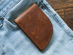 Made in Maine, this men's front pocket wallet has some advantages over the traditional back pocket style. It's safer to carry your billfold in the front, and can also be less stressful for your back. Crafted with moose leather, this wallet's curved design fits perfectly into curved front pockets to carry both cash and cards comfortably. For extra protection, it has RFID blockers stitched in.