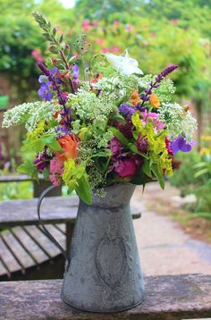 Early summer mixed bouquet in metal jug