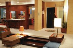 love the idea of a sunken living room... would be perfect in a lodge house by a lake.