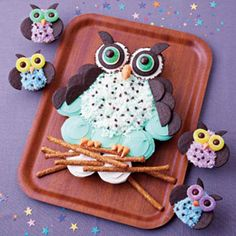 "love the pretzel ""branch.""  Cupcakes look like they've used the store equivalent of thin mints for the wings and ""ears.""  m & m's and gummy lifesavers for the eyes.  SO adorable.  Definitely need to make for something."