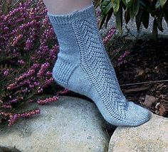 Made from wicking, lightweight bamboo with just enough wool for some elasticity, the Lacy Spring Socks are a great warm-weather sock. These socks were actually inspired by a commercial for rheumatoid arthritis medication, if you can believe it. They feature a lace front with a stockinette back. The lace pattern is simpler than it appears and is fairly easy to memorize. The instructions for the lace are both written and in chart form.