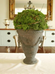 Moss urn - moss ball made from newspaper.