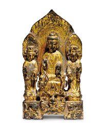 Lot 185 A RARE GILT-BRONZE BUDDHIST TRIAD  WESTERN WEI DYNASTY (535-556)  Price Realised   USD 46,600