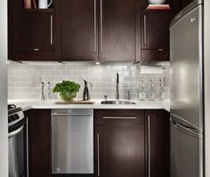 Contemporary U-shaped Grey kitchen, walnut cabinets, $20,000 - $50,000,