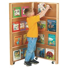 Find out more about the Jonti-Craft®Mobile Library Bookcase - 2 Sections today! Two-sided panels with sixteen shelves provide 32 linear feet for book display. Elastic cord holds books in place. Folds flat for storage. Each panel is 24 Corner Shelving Unit, Book Shelves, Mobile Library, Kids Bookcase, Book Storage, Easy Storage, Book Holders, Panel, Early Learning