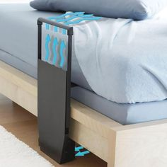 The Bed Fan delivers a cool breeze between the sheets without AC costs....I NEED THIS!!