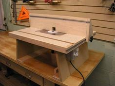 I love this little table, too bad the site doesn't exist anymore... will have to reverse engineer it I guess if i want to build this one. --Router Table