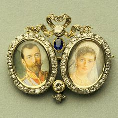 Brooch with Miniatures of Nicholas II and Alexandra by Fabergé (firm); Perkhin, Mikhail (workmaster) c. Gold, diamonds, sapphire, and miniatures Faberge Jewelry, House Of Romanov, Alexandra Feodorovna, Tsar Nicholas Ii, Miniature Portraits, Royal Jewelry, Jewellery, Faberge Eggs, Imperial Russia