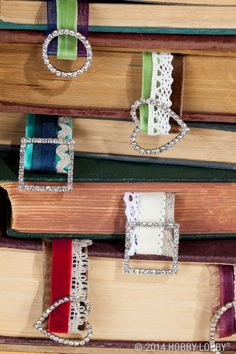 These bejeweled bookmarks are made from a combination of ribbons with sparkly accessories added on.