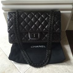 Authentic Chanel reissue so black medium handbag Authentic Chanel reissue so black medium shoulder bag. Great used condition, some minor rubbing on the corners. Please email me for additional pics. Will come with dustbag, authenticity card is missing which reflects in the price. Absolutely gorgeous and extremely hard to find!! 9.5 x 6 x 3 inches. Purchased in 2011 CHANEL Bags Shoulder Bags