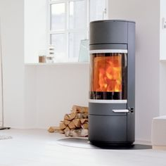 Kernow Fires Scan 45 mini on a circular steel hearth wood burning stove installation in Cornwall. Wood Burning Logs, Stove Installation, Freestanding Fireplace, Log Burner, Curved Glass, Hearth, Room Interior, New Homes, House Styles
