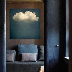 There's just so much to love about this room by Axel Vervoordt. It's like looking through a secret doorway to layers of blue, clouds, and so many dimensions of comfort. #axelvervoordt
