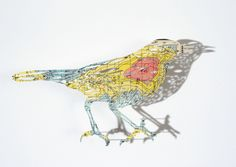 Incredible! Hand-cut birds made from maps: Claire Brewster's delicate paper-cut map birds