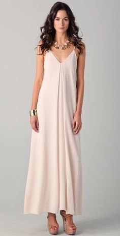 This V-neck crepe Alice + Olivia dress features an inverted pleat at the front. Adjustable spaghetti straps.