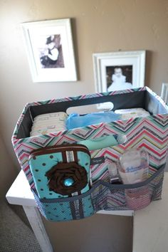 Diaper Caddy! i love selling this stuff... you can use this for diapers now and then use it with hanging file folders to store artwork later. Thirty One Fold-n-File used as an on the go diaper caddy! Order online at mythirtyone.com/jamierawson   http://traffurl.com/?g/2QANxSL