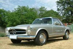 In my garage..1968 Mercedes-Benz 280SL ----this pic would be useful for a mercedes add