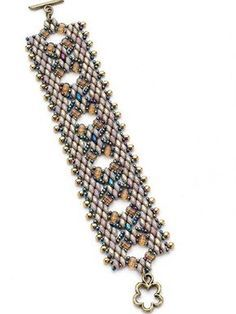 $ Enjoy the openwork center that develops and features rullas. Use an intriguing combination of peyote stitch and netting to form bands of Superduos. Finished Size: 7