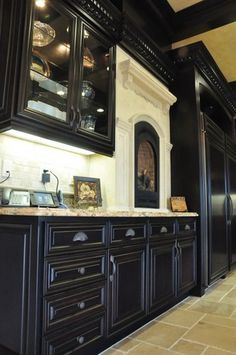 Counter level fireplace black cabinetry and subway tile