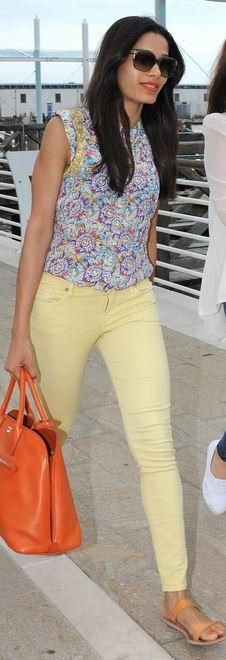 Who made Frieda Pinto's orange handbag, brown sandals, watch, yellow skinny jeans, and print top that she wore in Venice on September 1, 2013? Shirt – Zadig & Voltaire Watch – Jaeger-LeCoultre Purse – Prada Jeans – Citizens of Humanity Shoes- K. Jacques