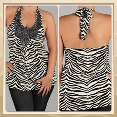 Love this Zebra top in Plus size...for the curvy girls.  In stock at La Boutique! www.shopLaBoutique.com or www.facebook.com/shopLaBoutique