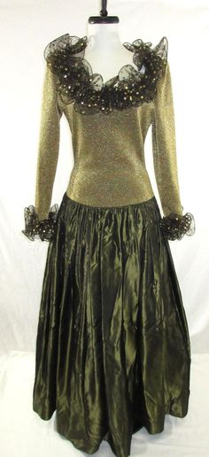 """Luxurious Gold Metallic Lurex Bodice & Acetate Full Olive Green, Lined, Netted, Drop Waist Ball gown, With Black/Gold Net Ruffled Collar & Sleeves.  Tagged Oscar De LaRenta- 34/36"""" Bust, 28"""" Drop Waist, 32"""" Sleeve from Back of Neck, 15"""" Shoulders & 58"""" Long."""