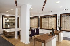 Optic Store by FREDERIC FLANQUART, via Behance -  love the check in area