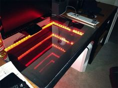 Redditor JacksRagingHormones has used mirrors, glass, a Raspberry Pi single-board computer and a focused light source for his infinite effect computer desk.