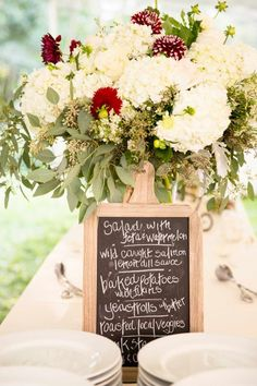 Beautiful Rustic Mountain Wedding centerpiece of white hydrangea, eucalyptus, wildflowers, white roses and mums, with a rustic hand written chalkboard menu. Pic:  J&D Photography