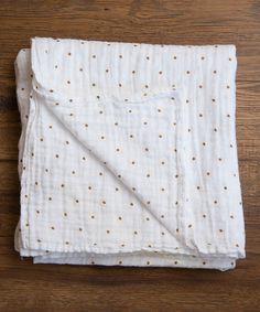 gold dotted muslin blanket — love!