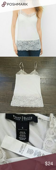 {WHBM} Lace Spandex Camisole White House Black Market beautiful cami tank top. Ecru color: oatmeal cream (a white/taupe).   Nylon/spandex fabric blend makes this extraordinarily stretchy. It's also very long! Goes past the hips, even on taller women, which is great. Adjustable shoulder straps. Wide lacey top and bottom. EUC.   I offer a 20% bundle discount. Cheers!  ***No modeling. No trades.*** White House Black Market Tops Camisoles