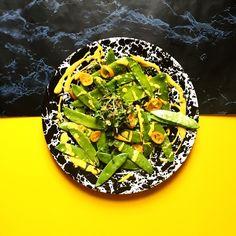 The trip continues ⚡️ snow peas tossed with chermoula / pickled kumquat / micro radish / tumeric tahini ⚡️