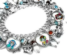 This amazing day of the dead charm bracelet features over 35 gorgeous charms with colorful images, fresh water pearls, swarovski crystals and silver charms, created in Stainless Steel.  Día de los Muertos is a holiday celebrated in Mexico and by Mexican Americans living in the United States and Canada. The holiday focuses on gatherings of family and friends to pray for and remember friends and family members who have passed on. This piece went handmade viral as of 11-01-2015 on Facebook Fan…