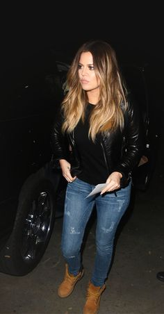Khloe Kardashian is photographed leaving the Miley Cyrus concert wearing a  leather jacket eac7eb827