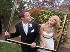 Christian and Brooke in a fun prom picture with a picture frame. (Creative homecoming/prom pics).