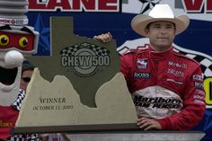 October 12, 2003: Gil de Ferran, driver of the #6 Marlboro Team Penske Toyota, displays the Indy Racing League Chevy 500 winner's trophy in Victory Lane.