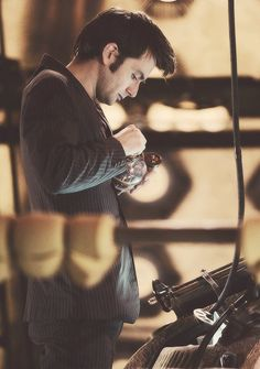 the Tenth Doctor tinkering around in the TARDIS ... I feel like if I were there I would just sit and stare at him dreamily (and possibly drool) XD