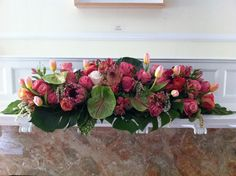 Long arrangement with gorgeous antherium from Chic Floral Design