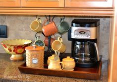 My New Coffee Station : houseontheway --- pp: I am a little bit in love with the mugs, mug tree, creamer & sugar and basket! Coffee Nook, Coffee Wine, Coffee Corner, My Coffee, Coffee Bars, Kitchen Themes, Kitchen Decor, Kitchen Layout, Kitchen Storage