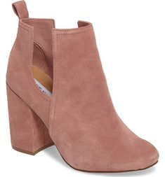 Breezy side cutouts refresh a Chelsea-inspired bootie styled with a gently rounded toe and elevated by a wrapped block heel.