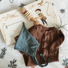 Newborn baby flatlay. Pixie bonnet. Organic l'oved baby gown