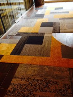 interface carpet tile pattern at the entry of their showroom