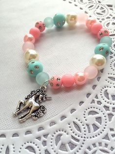 Unicorn party, unicorn bracelet, beaded children jewelry, rainbow party, pastel party, birthday party favor, kids birthday gift. SET of TEN.  **************************  Party planning is already so stressful. Leave the favors up to us!  This listing is for TEN bracelets.  DETAILS and