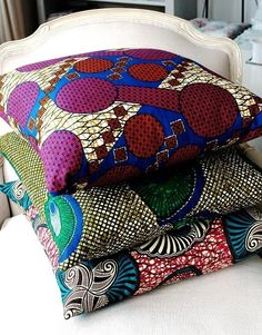 Then on top I'd pile a clash of as many brightly coloured African cushions as I could fit - some big, some small