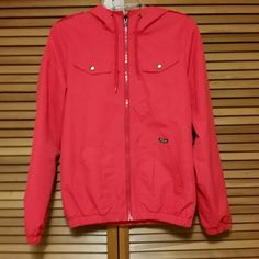 Volcom red windbreaker size small This is an adorable bright red volcom windbreaker. The waist is elastic but not drawstring so u can't adjust it to make it tighter or looser. Hate to part with this but it doesn't fit me anymore! It is in near perfect condition. Volcom Jackets & Coats
