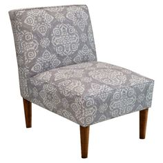 Upholstered accent chair with foam cushioning and a pine wood frame. Handcrafted in the USA.   Product: Accent chair