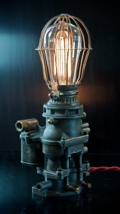 Machine Age Ford Carburetor Lamp with bird cage cover. $265.00, via Etsy.